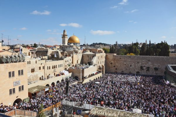 18723689 - the western wall in jerusalem temple. the area in front of it filled with people from morning prayers. the most joyous holiday of the jewish people - sukkot.